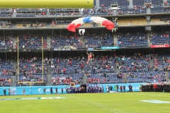 The Frog-X parachute team came into the stadium with a focus on entertaining the crowd.